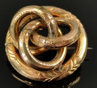 Brooch made of three intertwined circles, around them another circle, all chased with floral motifs,
