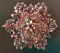 Garnet brooch, 5-tiered, set with round and oval faceted garnets, around 1900, gilded, ca. 4cm