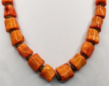 Coral necklace, cylindrical elements alternating with small wooden discs, lobster clasp, length