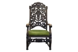 Armchair with carved backrest