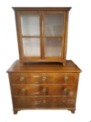 Austria, early 19th century.Walnut with rounded pilaster strips, 2 parts. 3 drawers and 2 glazed