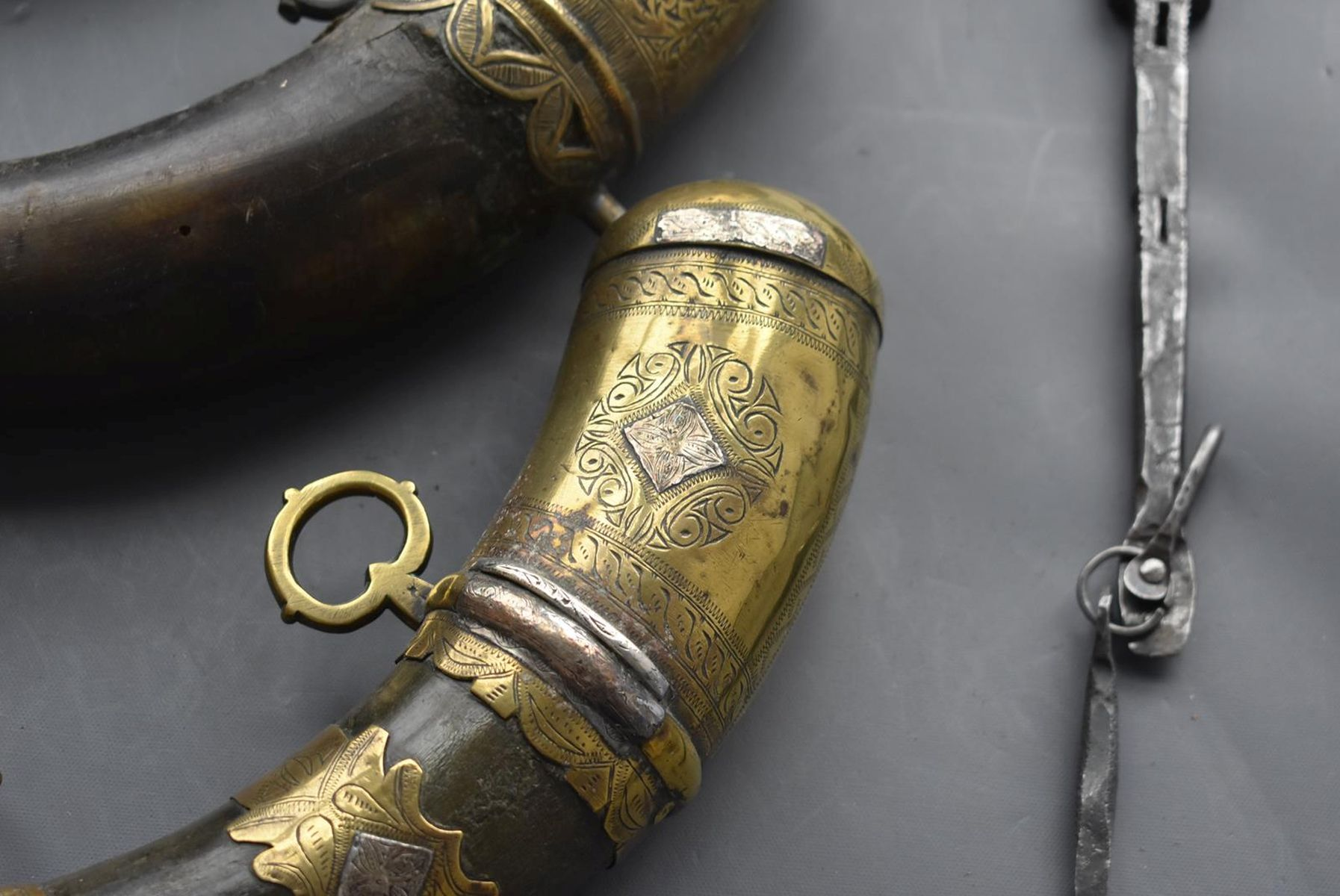 THREE VARIOUS NORTH AFRICAN POWDER HORNS, each of natural curving form with ornate brass mounts, - Image 3 of 11