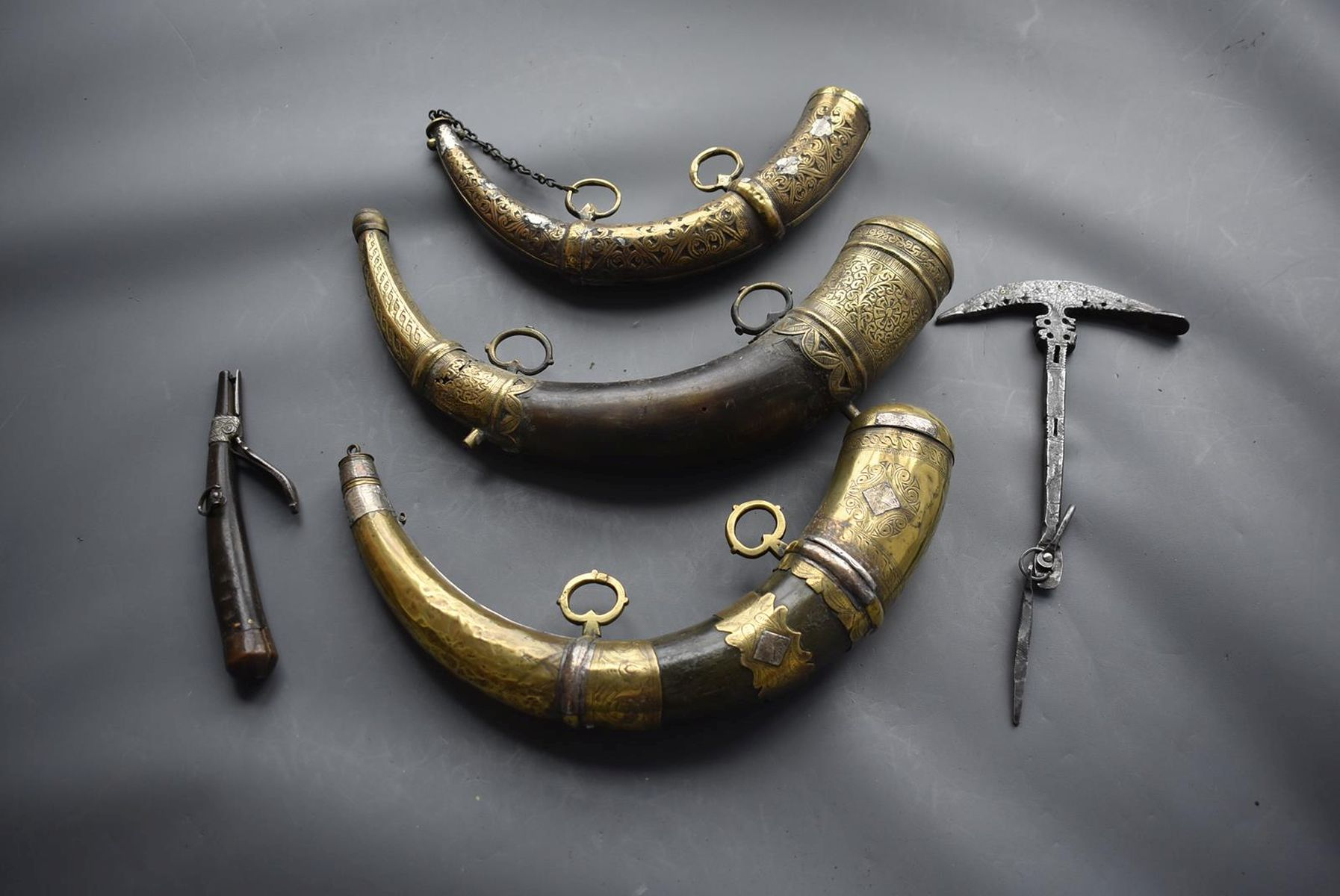 THREE VARIOUS NORTH AFRICAN POWDER HORNS, each of natural curving form with ornate brass mounts, - Image 2 of 11