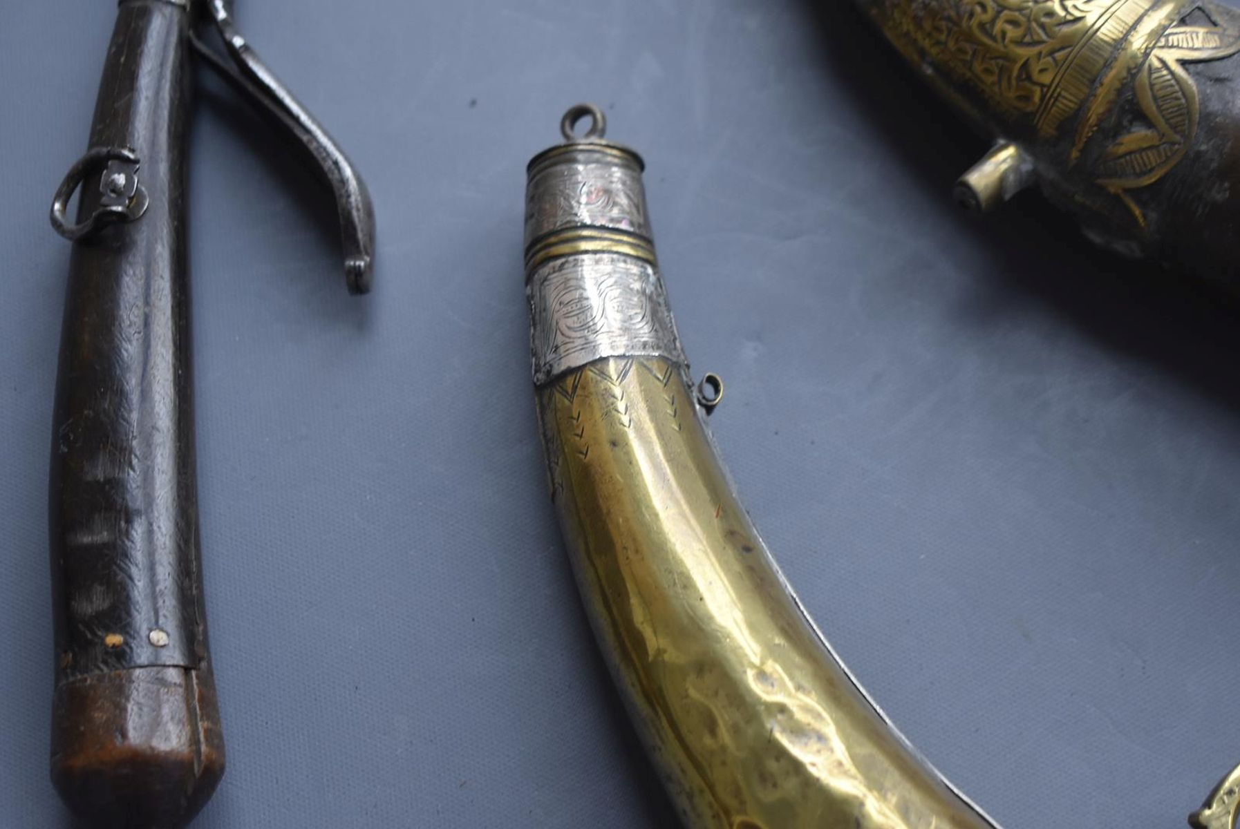 THREE VARIOUS NORTH AFRICAN POWDER HORNS, each of natural curving form with ornate brass mounts, - Image 8 of 11