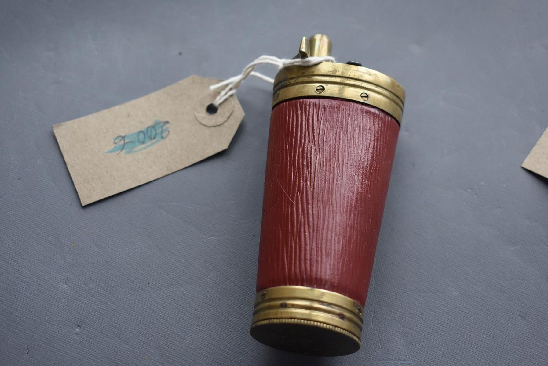 A GOOD COPY OF THREE-WAY POWDER FLASK, the brass mounted red leather wrapped tapering body with - Image 2 of 10