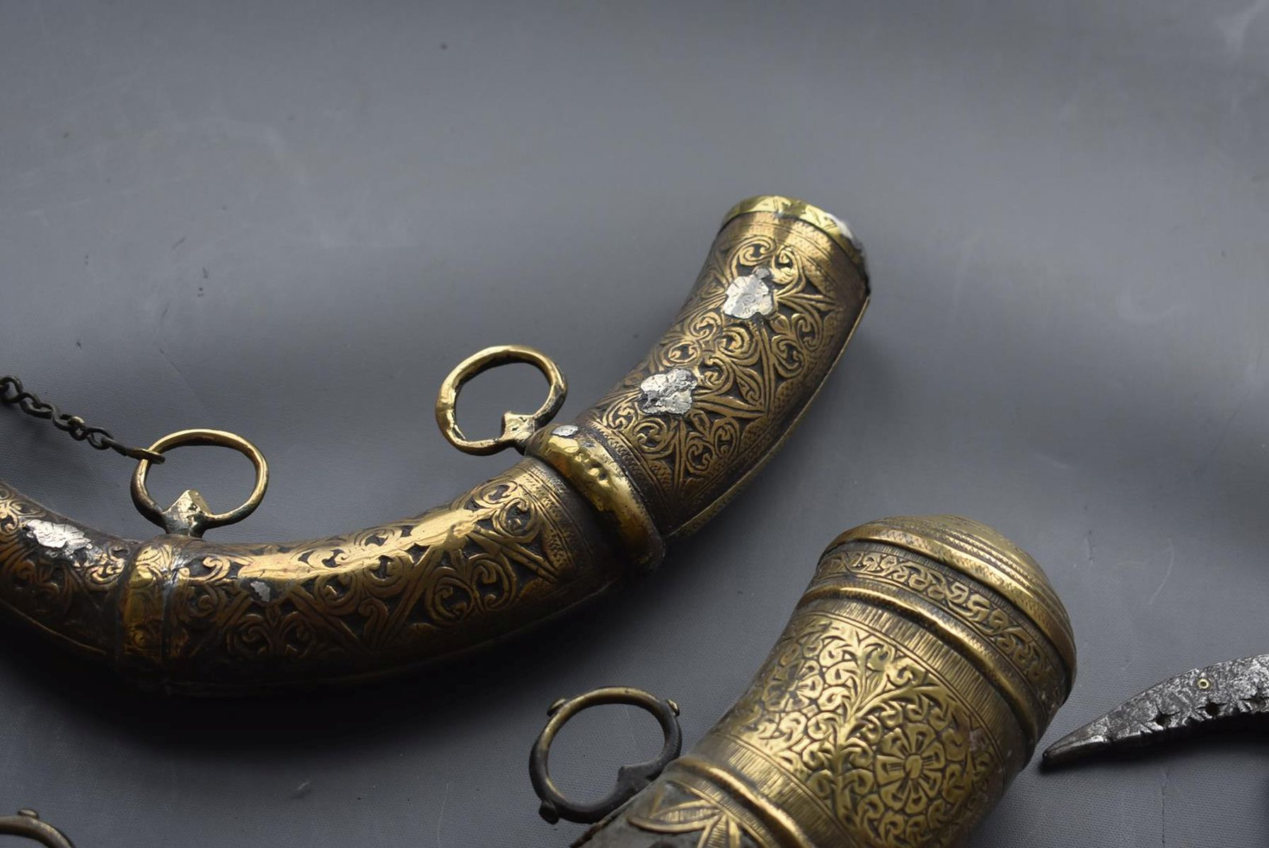 THREE VARIOUS NORTH AFRICAN POWDER HORNS, each of natural curving form with ornate brass mounts, - Image 5 of 11