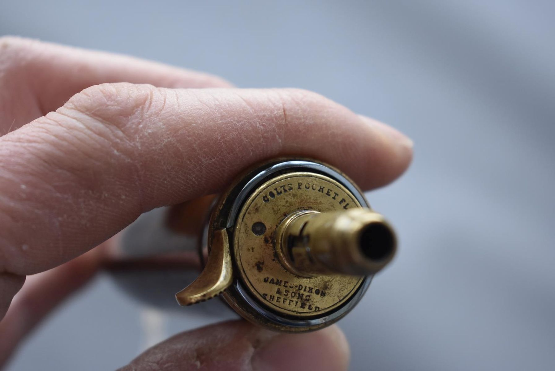 A JAMES-DIXON & SONS COLT POCKET POWDER FLASK, the bag-shaped copper body with traces of lacquered - Image 3 of 10