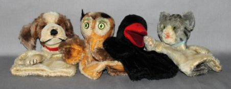 Kinderspielzeug. Steiff. Vier Handpuppen -  Pinguin, Eule, Hund und Katze. Drei Handpuppen original