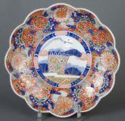 Imari-Platte. Japan. Porzellan, unterglasurblau bemalt, reich farbig überdekoriert, D=35,5 cm. (
