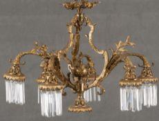 Achtflammige Deckenlampe. Frankreich 20. Jh. Bronze, vergoldet, mit Glasprismen, H=58 cm, D=71