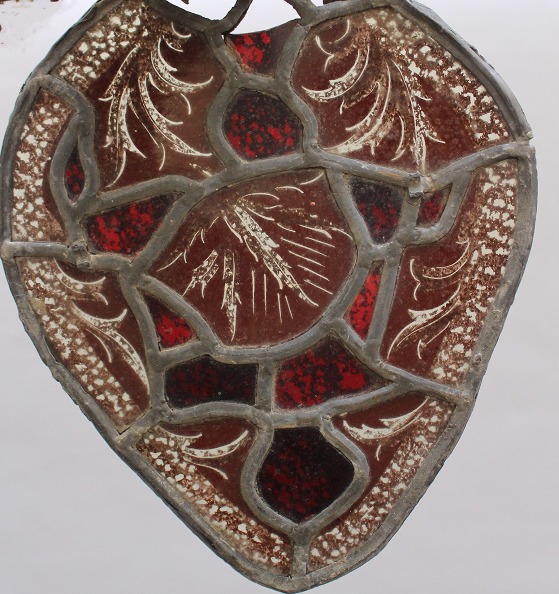 Glass window in medieval manner, red and black coloured leaves, in pewter frame,parts missing. - Image 2 of 3