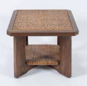Tavolo in legno con inserti in midollino pressato. Prod. Italia, 1980 ca. Cm 70x70x56.