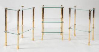Tre tavoli bassi in ottone e in vetro. Prod. Italia, 1980 ca. Cadauno di cm 56x35x25.