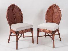 VIVAI DEL SUD, attr. Coppia di sedie in bamboo curvato e canna d'india e tessuto. Prod. Italia, 1970