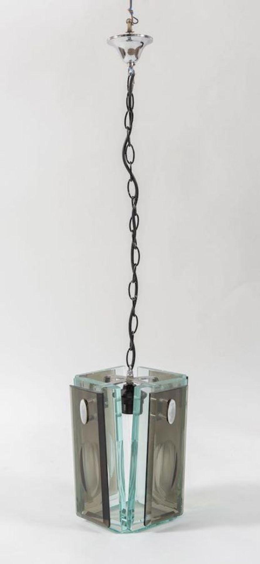Lampadario in vetro molato con struttura in metallo. Prod. Italia, 1970 ca. Cm 100x24x24.