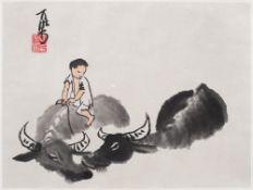 Boy with buffalos bathing