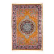 Qum silk rug, richly decorated with floral motifs, Iran