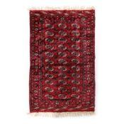 Tekke-Buhara wool rug, decorated with traditional geometric motifs, Iran, mid-20th century