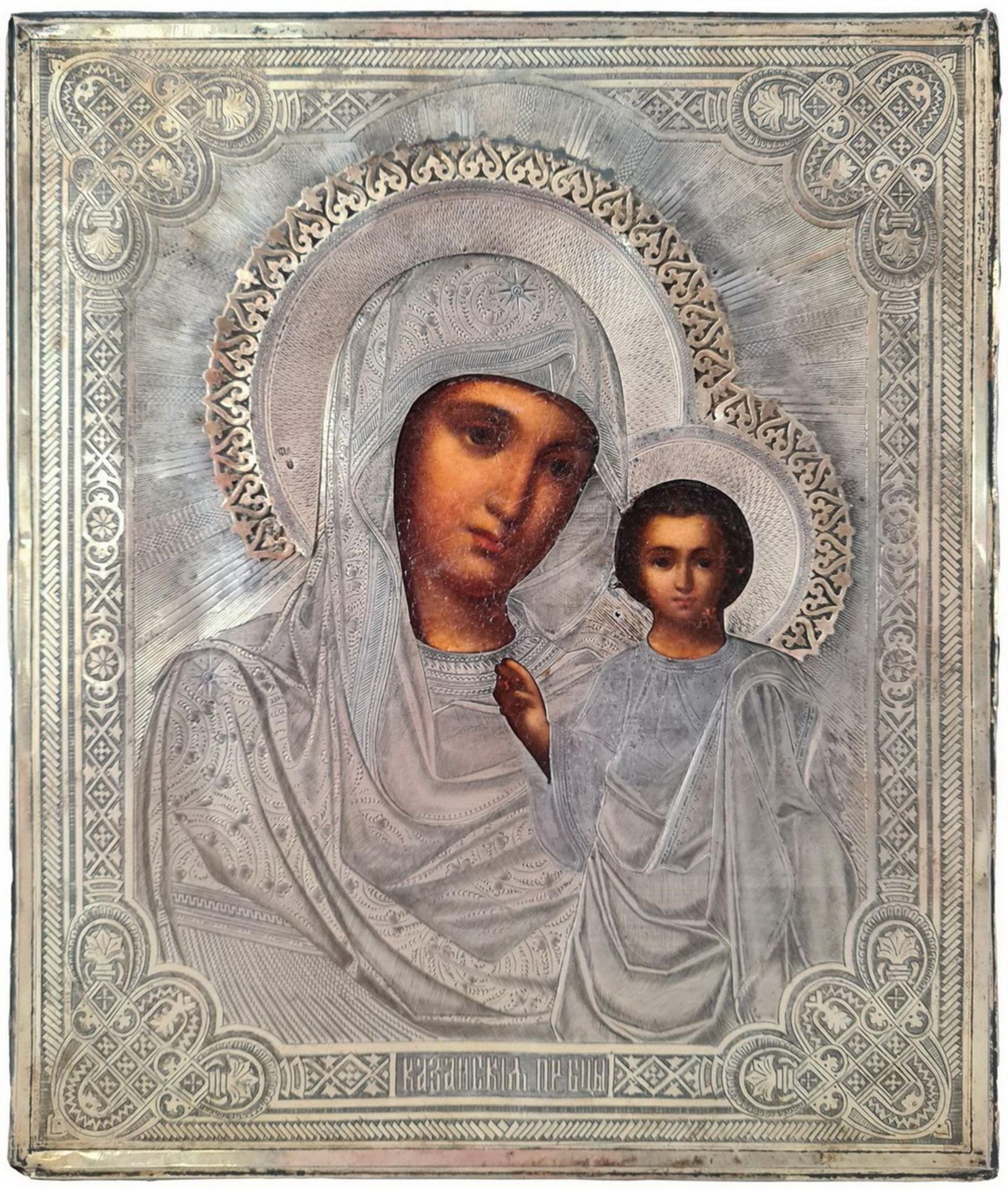 """Russian icon """"Kazanskaya Mother of God"""" with silver oklad. - Moscow, 1881; 31x27 cm.<br>Oil on wood,"""