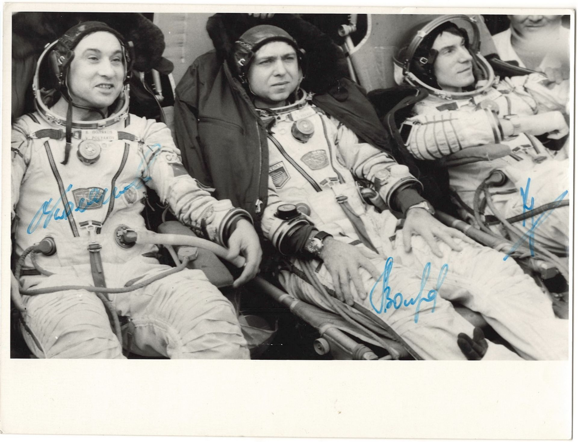 [Soviet cosmonauts, autograph]. Cosmonauts Sergei Krikalev, Aleksandr Volkov and Valery Polyakov. Ph