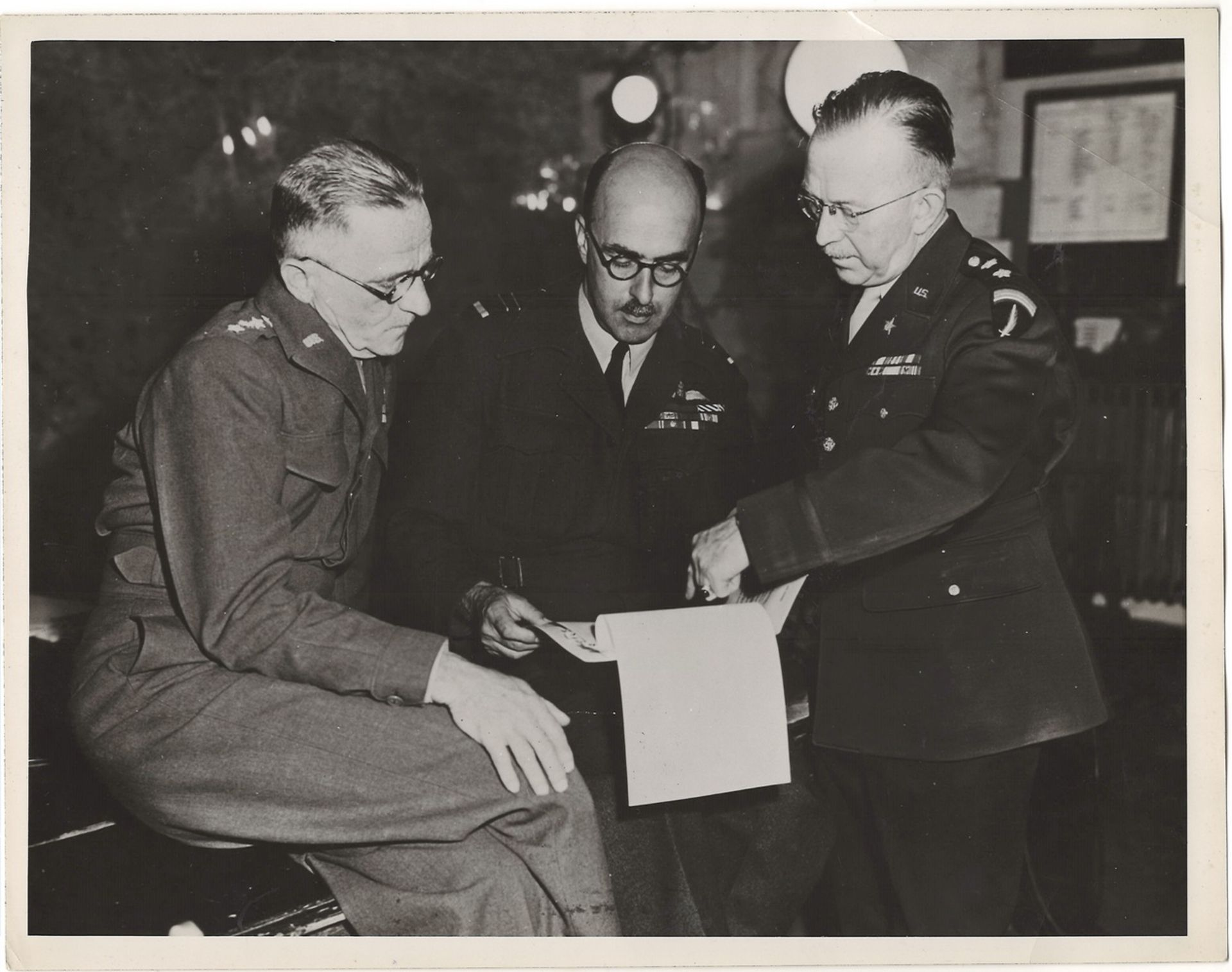 """Carl Spaatz, J. Robb and H. Bull at meeting in Reims"""". 5th May, 1945. Photograph 21x26 cm. <br>"""
