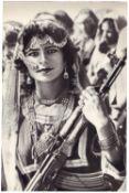 """[Soviet–Afghan War]. Photograph """"Woman with an assault rifle"""". Original print. 1986. 11,3x7,6 cm."""