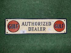 A CAST 'GULF AUTHORISED DEALER' WALL PLAQUE