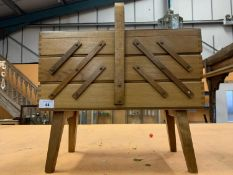A VINTAGE WOODEN CANTILEVER SEWING BOX
