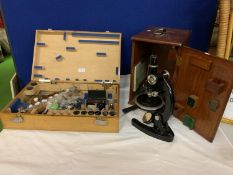 A BOXED VINTAGE COOKE MICROSCOPE WITH INSTRUCTION MANUAL TO INCLUDE A FURTHER BOX CONTAINING SEVERAL