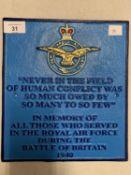 A PAINTED CAST IRON RAF PLAQUE