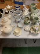 A LARGE ASSORTMENT OF COPELAND SPODE TEAPOTS AND JUGS TO INCLUDE ROYAL DOULTON EXAMPLES