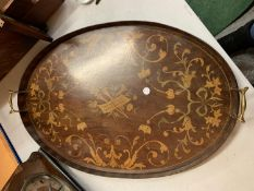 A VINTAGE INLAID WOODEN OVAL TRAY WITH BRASS HANDLES - WIDTH 64CMS