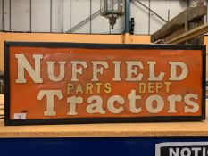 AN ILLUMINATED 'NUFFIELD PARTS DEPT TRACTORS' SIGN
