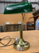 A BRASS BANKERS LAMP WITH GREEN SHADE