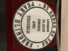 "A CAST METAL PEAKY BLINDERS ""LONDON"" CIRCULAR SIGN"