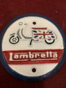 """A CAST METAL """"LAMBRETTA"""" CIRCULAR SIGN"""