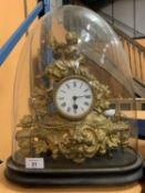 AN ORNATE GILDED FRENCH MANTLE CLOCK WITH DOMED COVER - MAKER B B BREVETE, PARIS