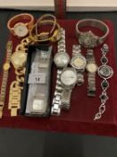 AN ASSORTMENT OF WRIST WATCHES WITH METAL STRAPS TO INCLUDE A LORUS, A REPRODUCTION ROLEX ETC