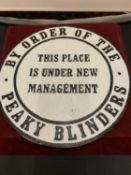 """A CAST METAL PEAKY BLINDERS """"UNDER NEW MANAGEMENT"""" CIRCULAR SIGN"""