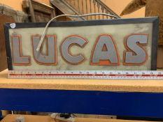 """AN ILLUMINATED """"LUCAS"""" SIGN"""