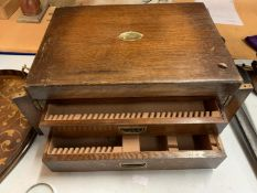 A LARGE WOODEN FLATWARE BOX WITH TWO DRAWERS AND HINGED LID WITH BRASS DETAIL