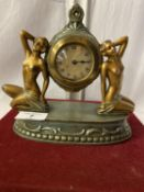 AN ART DECO STYLE MANTLE CLOCK FEATURING TWO NUDES - HEIGHT 18CMS