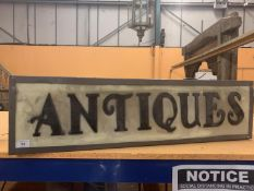 AN ILLUMINATED 'ANTIQUES SIGN'