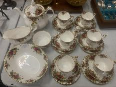 A ROYAL ALBERT 'OLD COUNTRY ROSES' TEA SET TO INCLUDE SIX TRIOS, TEAPOT AND SERVING BOWLS