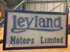 AN ILLUMINATED 'LEYLAND MOTORS LIMITED' SIGN