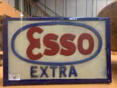 AN ILLUMINATED 'ESSO EXTRA' SIGN