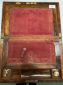 A VINTAGE WOODEN WRITING SLOPE WITH BRASS DETAIL TO INCLUDE A PAIR OF GLASS INK WELLS AND A KEY