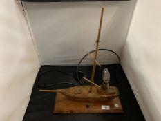 A 1940s WOODEN OAK YACHT LAMP