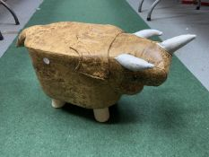 A SMALL T-REX CHILD'S FOOTSTOOL