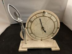 AN ART DECO STYLE MANTEL CLOCK WITH WHITE METAL FIGURINE DETAIL